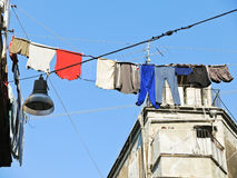 Clothes drying on the rope outdoors Stock Images