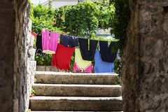 Clothes drying on the street stock photo