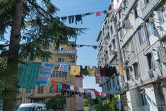 Clothes drying in traditional way on the street of Batumi, Georgia Stock Photo