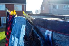 Clothes drying on a washing line. Clean laundry drying on a washing line in a residential garden stock images