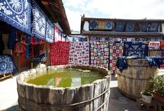 Clothes dyeing. Hand-dyeing clothes drying under sun in lijiang ,yunnan Province, China stock photography