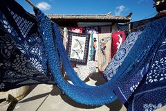 Clothes dyeing. Hand-dyeing clothes drying under sun in lijiang ,yunnan Province, China stock image