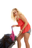 Clothes fallin out of suitcase Royalty Free Stock Images