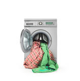 Clothes falling out of the washing machine Royalty Free Stock Image