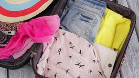 Clothes fills suitcase. stock video footage
