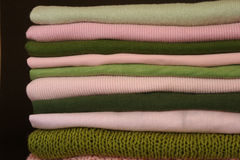 Clothes folded and stacked. Pink and green clothes folded and stacked Royalty Free Stock Photos