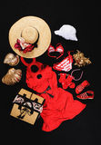 Clothes for girls for beach. Dress, hats, shoes and bag on black background for goin in beach royalty free stock photo