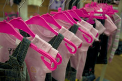 Clothes hang on hangers in shop Stock Photo