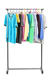 Clothes on hang rail. On white background royalty free stock photo