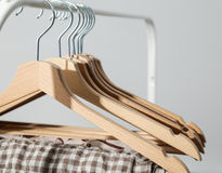 Clothes hang on a shelf in  designer clothes store Stock Images