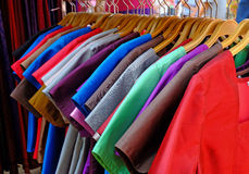 Clothes hang on the shelf Stock Photography