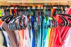 Clothes hang on a shelf Royalty Free Stock Photos