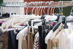 Clothes hang on a shelf Royalty Free Stock Photo
