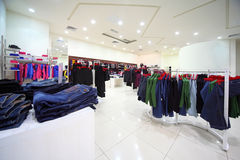 Clothes hang in shopping center Stock Photo