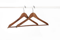 Clothes hanger. Two wood coat hanger on white Royalty Free Stock Photos