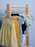 Clothes hanger. In childish room royalty free stock photo