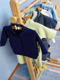 Clothes hanger. In childish room stock image
