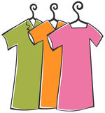 Clothes with hanger Stock Images