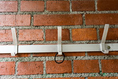Clothes hanger on brick wall with hairband Stock Photos