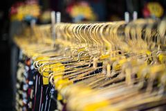 Clothes hanger closeup of fashion shop. Closeup of clothes hanger in fashion shop royalty free stock image