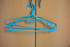 Clothes hanger hang on wooden background. royalty free stock image