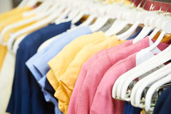Clothes on hanger in shop. Shoping sale background theme. clothes on hanger in shop Royalty Free Stock Photo