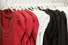 Clothes on hanger in shop Stock Image