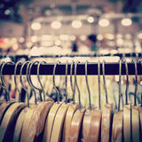 Clothes hanger in shop. With vintage toned Royalty Free Stock Photo