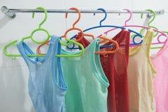 Clothes hanger with  sleeveless children`s shirt Stock Photos