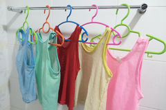 Clothes hanger with  sleeveless children`s shirt Royalty Free Stock Photography