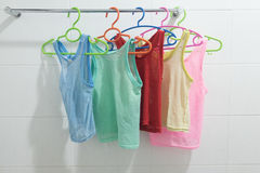 Clothes hanger with  sleeveless children`s shirt Stock Photography
