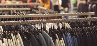 Clothes on hanger, store background Stock Images