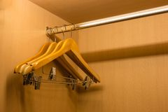 Clothes hanger in wood wardrobe Stock Photography