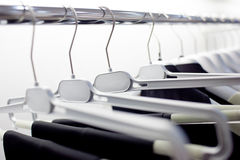 Clothes hangers. Hangers of clothes in clothing store Royalty Free Stock Images