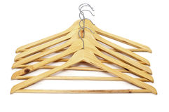 Clothes hangers. Some wooden clothes hangers on a white background stock images