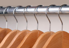 Clothes Hangers. Empty Wooden Clothes Hangers Hanging On A Metal Rail Royalty Free Stock Photo