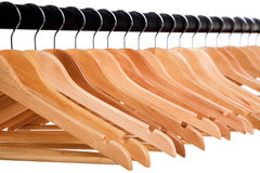 Clothes hangers. Row of clothes hangers on a rail Royalty Free Stock Images