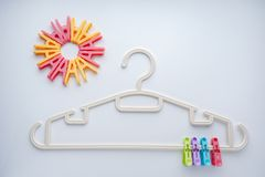 Clothes hangers and clothes clamps stock images