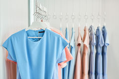 Clothes on hangers at clothing store. Women's clothes on hangers in a clothing store Royalty Free Stock Image