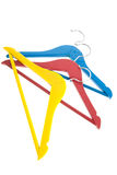 Clothes hangers. Colorful clothes hangers in yellow, red and blue isolated over white background Stock Photos