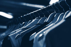 Clothes hangers in fashion store. Clothes business concept Royalty Free Stock Image