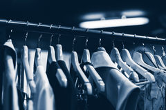 Clothes hangers in fashion store. Clothes business concept Royalty Free Stock Images