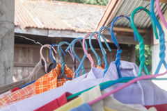 Clothes hangers multicolored . . Clothes hangers multicolored in home royalty free stock image