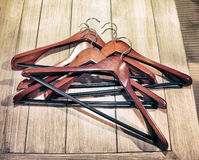 Clothes hangers,  photo in old image style. Modern clothes hangers, wood, metal, brown,  photo in old image style Stock Photography