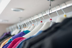 Clothes on hangers Stock Photos