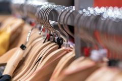 Clothes on hangers on racks in mass market. XS size Royalty Free Stock Photos