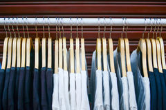 Clothes on hangers on a shelf in the store Stock Photography