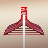 Clothes hangers with a sign Sale Stock Image