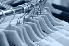 Clothes on hangers(toned). Clothes on hangers at the shop, shallow DOF, toned version Royalty Free Stock Photos