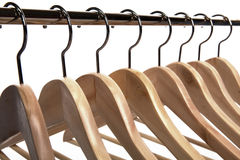 Clothes Hangers on a White Isolated Background. Wooden Clothes Hangers on a White Isolated Background Stock Photography